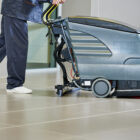 Cleaner pre-sweeping with a floor scrubber dryer